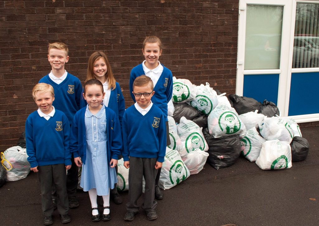 school pupils recycling clothing in aid of gnaas
