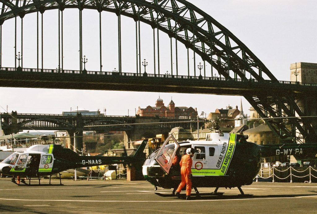 G-WYPA helicopter with G-NAAS helicopter at Tyne Bridge