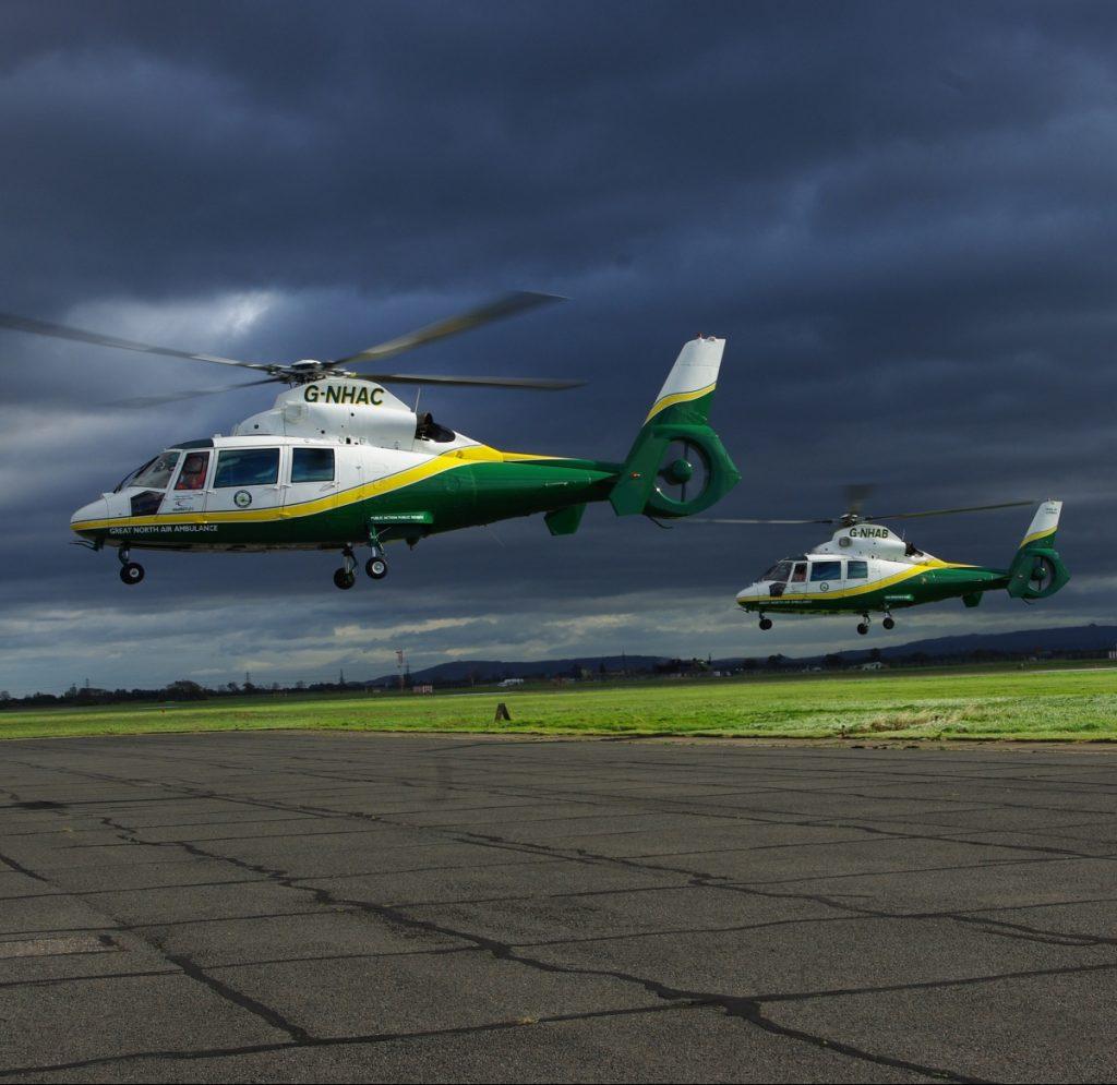 G-NHAA, G-NHAB, G-NHAC - the three GNAAS helicopters, in flight