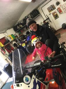Ronnie Murray and his granddaughter Darcy on his bike