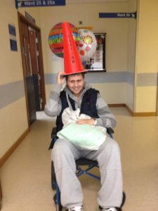 Kai Kristiansen with a cone on his head in hospital